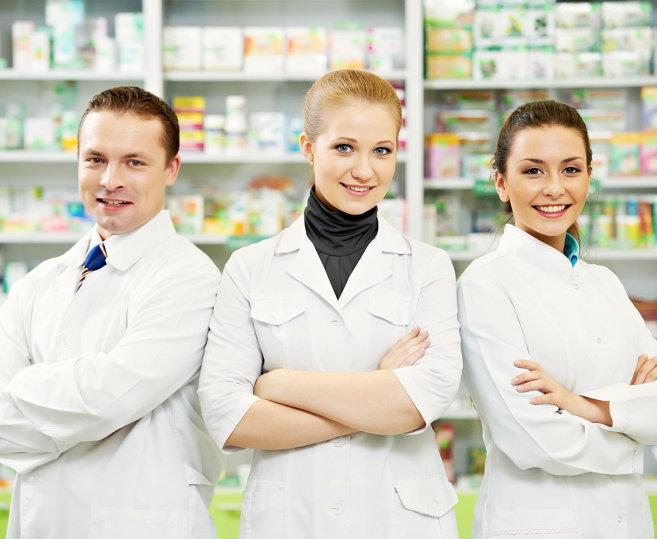 three pharmacist smiling