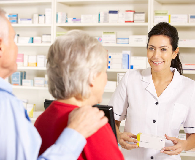 pharmacist smiling to the customers