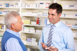 pharmacist and customer talking